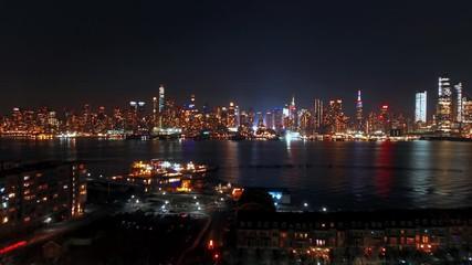 Fototapete - Midtown Manhattan skyline at night in New York City timelapse