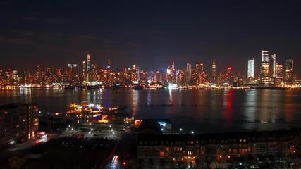 Wall Mural - Midtown Manhattan skyline at night in New York City timelapse