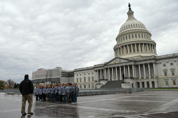Children on a school trip pose for a photo in front of the U.S. Capitol building on Capitol Hill in Washington