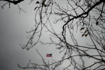 An American flag waves in the wind atop the Rayburn House Office Building on Capitol Hill in Washington
