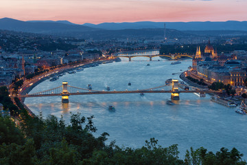 Sunset Budapest along Danube with Chain Bridge and Parliament Building
