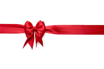 Red horizontal silk ribbon with a red festive beautiful bright bow tied on it isolated on a white background