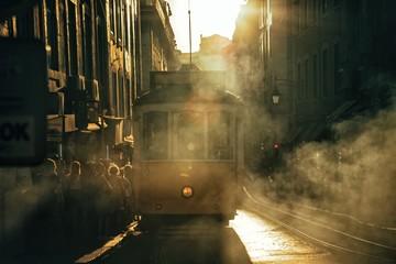 Foto tirada no centro da cidade de Lisboa-Portugal, com o elétrico e o fumo dos carros que deram todo o misterio da imagem.