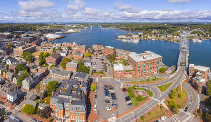 Portsmouth historic city center and Waterfront of Piscataqua River with Memorial Bridge aerial view, New Hampshire, NH, USA.