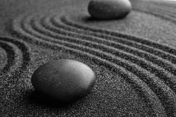 Foto op Plexiglas Stenen in het Zand Black sand with stones and beautiful pattern. Zen concept