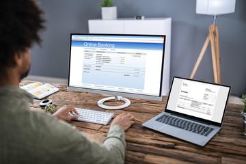 Businessman Using Online Banking Service On Laptop