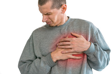 Young man holds hand on the chest because of pain in the heart or lungs. Distorted facial expression. Grimace of pain. Spasm. Heart. Сardiology. Isolated on a white background