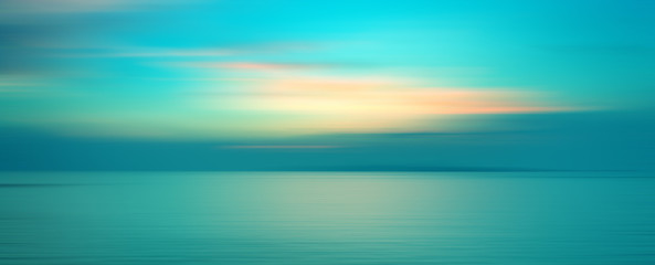 Printed roller blinds Turquoise Motion blurred background of sunset on the sea
