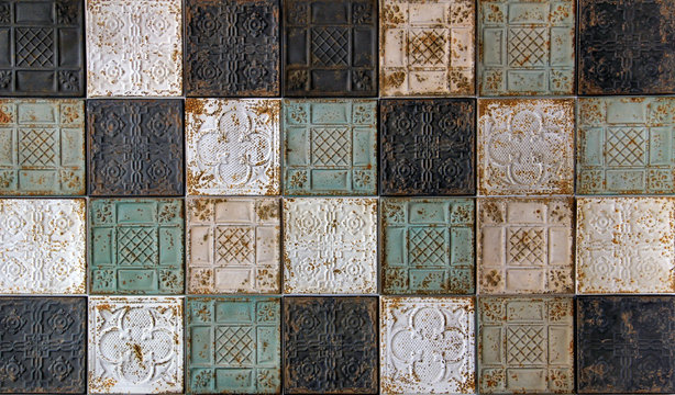 Rustic looking pressed tin antique ceiling tiles with oriental pattern, a beautiful background