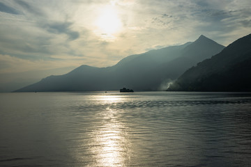 Scenic view of the Lake Maggiore at sunset on ferry boat cruising from Cannobio to Cannero Riviera, Piedmont, Italy