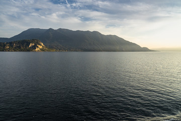 Scenic view of the Lake Maggiore at sunset on ferry boat cruising Luino to Stresa, Piedmont, Italy