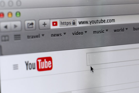 Photo of YouTube homepage on a monitor screen