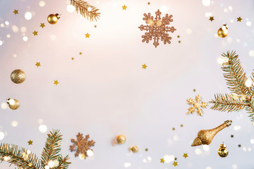 Merry Christmas and New Year background. Xmas holiday card made of flying decorations, gold fir...