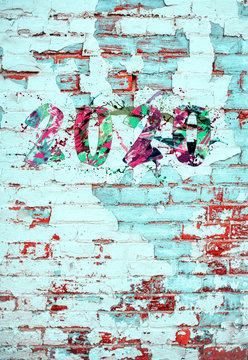2020 graffiti style paint splatter on brick wall New Year concept