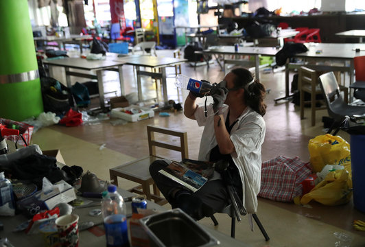 """A protester who calls himself """"Riot Chef"""", and who said he was a volunteer cook for protesters, sits in a canteen in Hong Kong Polytechnic University (PolyU)"""