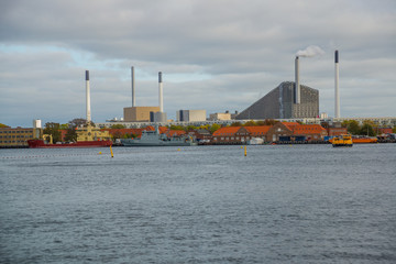 COPENHAGEN, DENMARK: Beautiful panoramic view from the waterfront to the buildings, boats and the river.