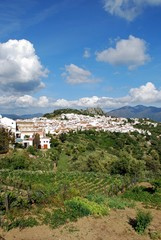 View of the white town with the castle and mountains to the rear., Gaucin, Andalusia, Spain.