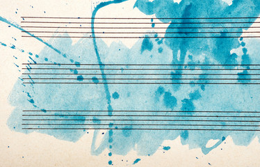 Old music sheet in blue watercolor paint. Blues music concept. Abstract blue watercolor background.