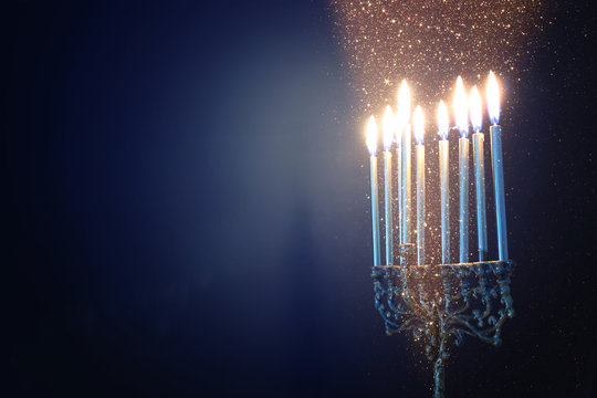 Religion image of jewish holiday Hanukkah background with menorah (traditional candelabra) and candles