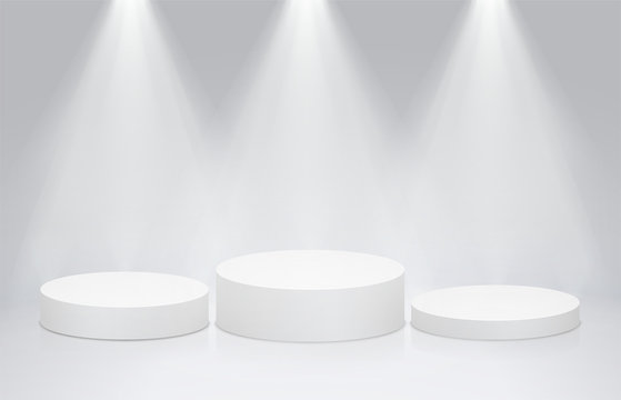 Round stage podium pedestal with bright lighting, spotlights. Winner podium, first second and third place for presentation of trophies or awards.