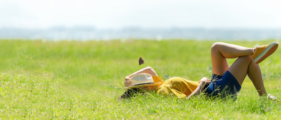 Woman relax and sleep chill  in the meadow  outdoor near sea beach.  Lifestyle and Vacations Concept