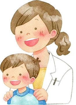 子供の肩に手を置く女性医師