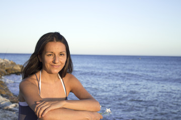 Portrait of smiling young girl with beach background