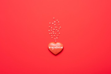 Be my Valentine. Red heart composition, top view, flat lay