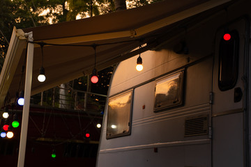 Fotorolgordijn Chocoladebruin Christmas LED light hang on the sunshade of motorhome at the end of the day.
