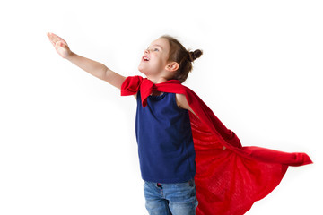 Wall Mural - Adorable little girl flying like a superhero in blue t-shirt and red mantle. Super girl. The new generation saves the world. Good triumphs over evil. Funny kid portrait