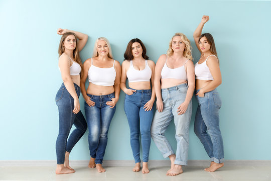 Group of body positive women near color wall