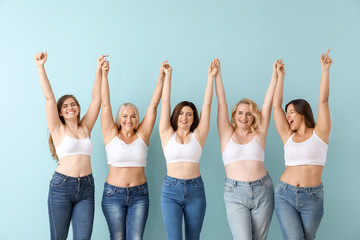 Group of body positive women on color background
