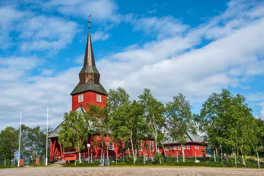 Wooden church in Kautokeino village in Norwegian Finnmark. The birch trees are around the church buildings.