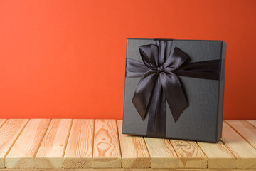 Black Friday sale concept with gift box on wooden table