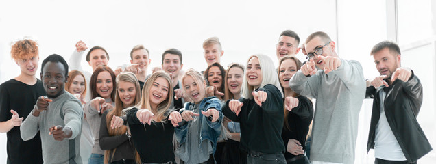 Fototapeta group of confident young people pointing at you obraz