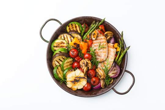 Seasonal summer grilled vegetables and chicken in a pan