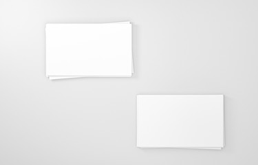 Two empty white business cards stack. Mockup for branding identity. Blank name card or poster on white background, studio shot. great for text & logo for design creative concept. 3D illustration