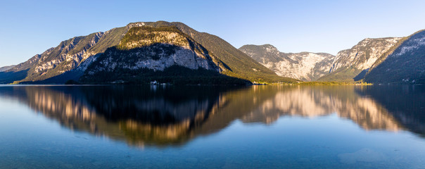 Beautiful reflection of the mountains around Lake Hallstatt
