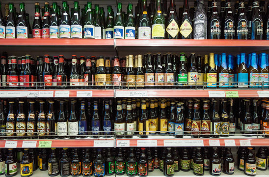 Variety of Belgian crafted beers for sale in a shop, branded bottles on shop shelf display in supermarket on 27 August, 2018 in Bruges, Belgium