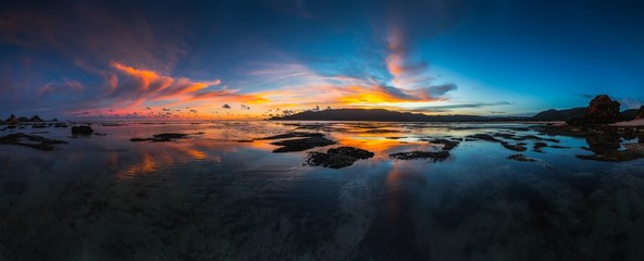 Printed kitchen splashbacks Black Panoramic shot of the reflection of the cloudy sky in the lake captured in Lombok, Indonesia