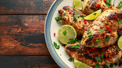 Homemade Grilled Chicken Breast in lime sauce with herbs Wall mural