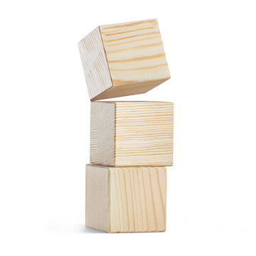 Tower of three wooden cubes, isolated on white background