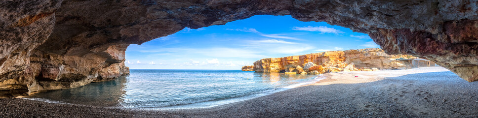 Beach of Spilies or Kitrenosi with sea caves near Rethimno, Crete, Greece. Fotomurales