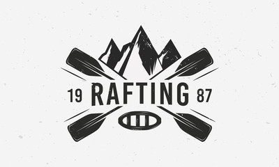 Mountains rafting logo with raft, crossed paddles and mountains silhouettes. Vintage typography. Vector illustration