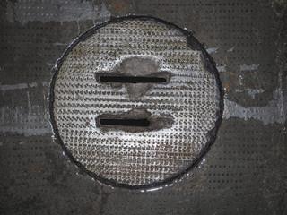 concrete drain manhole, grunge industrial background
