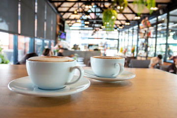A cup of fragrant cappuccino coffee. In the morning in the cafe, coffee makes the body refreshed.