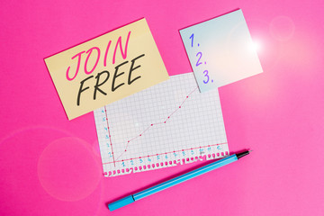 Writing note showing Join Free. Business concept for the act or an instance of joining a group or organization Stationary and note paper math sheet with diagram picture on the table