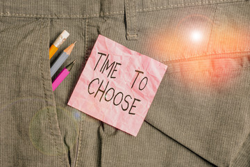 Text sign showing Time To Choose. Business photo text Judging the merits of multiple options and selecting one Writing equipment and pink note paper inside pocket of man work trousers