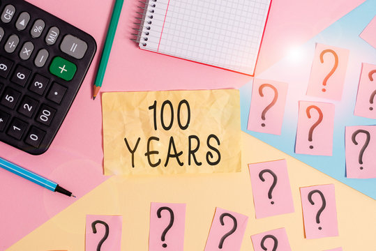 Writing note showing 100 Years. Business concept for Remembering special day for being 100 years in existence Mathematics stuff and writing equipment above pastel colours background