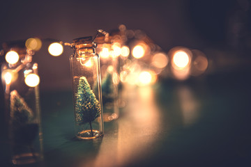Fototapete - Close-up, Elegant Christmas tree in glass jar on green color background. copy space